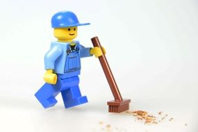 worker with push broom, lego blocks toy