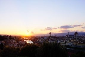distant view of city at sunset, italy, florence