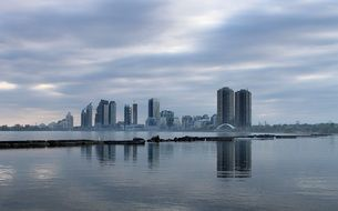 waterfront of city on lake at cloudy morning, canada, toronto