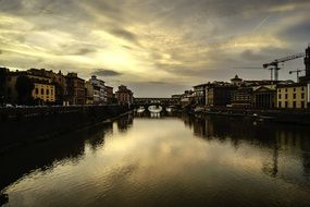 ponte vecchio, ancient bridge in cityscape at evening, italy, florence