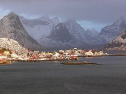 beautiful village at sea in mountain landscape, norway, lofoten islands, reine