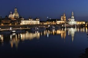 landmarks at Elbe river in night cityscape, germany, dresden