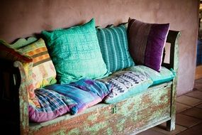 colorful pillows decor old wood bench