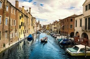 Photo of waterway with boats in Italy