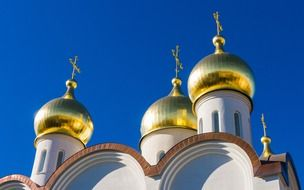 gold domes of orthodox church at sky, russia, moscow