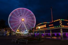 illuminated ferris wheel at a folk festival