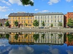 colorful houses with reflaction on calm water, poland, bydgoszcz
