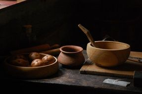 vintage wooden pots on kitchen table