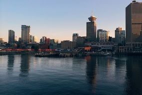 evening city skyline with towers at harbour, canada, Vancouver