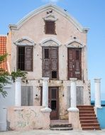 old abandoned building with columns at facade, netherlands, curacao, willemstad