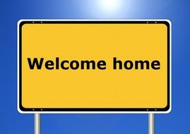 welcome home yellow sign road