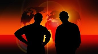 two men silhouettes at red background with globe