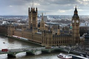 westminster palace in cityscape at cloudy day, uk, england, london