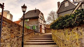 small timber framed houses at stone stairway in old town, germany, hattingen