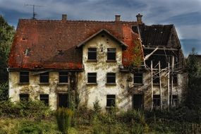 old ruined house with red tile roof