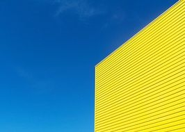 contrast blue yellow building sky