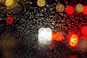 night view colored light raindrops glass