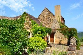 medieval house with well and fireplace in yard, france, dordogne