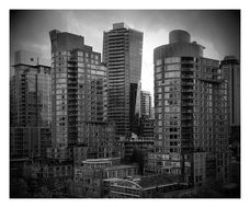 Grey photo of high buildings in town