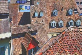 old red clay tile roofing in town