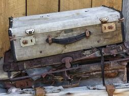 old grunge suitcases at deadman ranch building, canada, british columbia