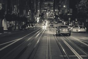 cars on road at night city