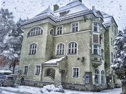old building on street in snowy weather, austria