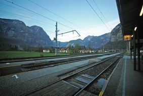 railway station at countryside in mountain landscape