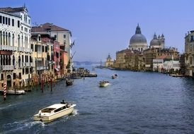 boats on grand canal in view of Santa Maria della Salute church, italy, venice