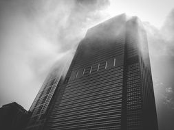 top of modern building in fog at sky