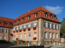old building with red tile roof, germany, speyer, edith stein platz