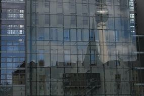 tv tower mirroring on glass facade, germany, berlin