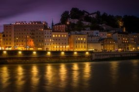night cityscape with salzach river, austria, salzburg