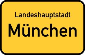 munich capital yellow town sign