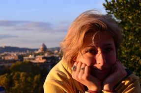 caucasian woman portrait in distant view of rome, italy