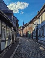 old truss houses at cobblestone pavement, germany, lower saxony