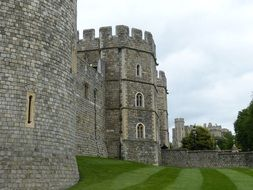 medieval windsor castle walls at cloudy sky, uk, england, london