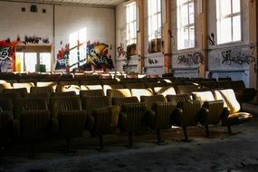 rows of seats in dirty interior of old abandoned cinema
