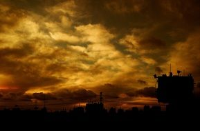clouds in sunset sky above industrial landscape