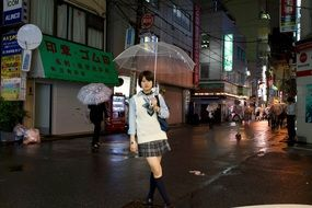 girl with umbrella in tokio street