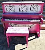 painted pink piano on streetside in city, canada, ontario