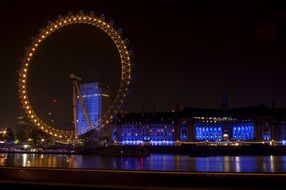 london eye ferris wheel and county hall at night, uk, england