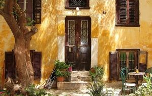 picturesque yellow facade of old house, greece, athens