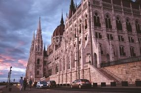 parliament building on street at evening, hungary, budapest