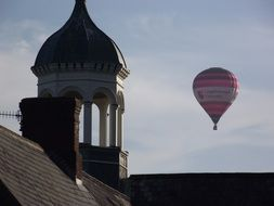 hot air balloon in sky at old tower