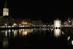 old city with water reflection at night, switzerland, zurich