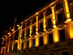 illuminated facade of old building at night, poland