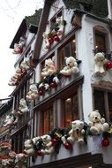 christmas decoration with white teddy bears on facade, france, strasbourg