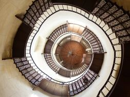deep spiral staircase with forged steps
