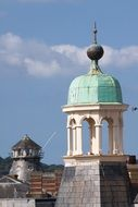 old green copper dome on arched columnar at sky, england